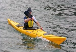 man in a rigid kayak